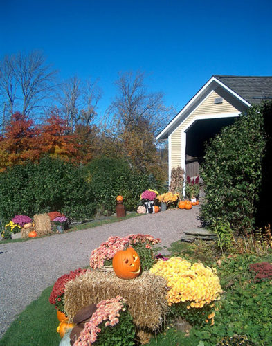 Pumpkins and fall decorations outside The Round Barn in Waitsfield, VT